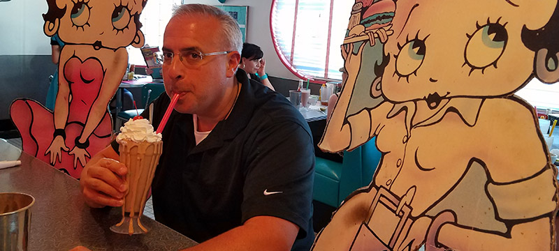 Man with milkshake